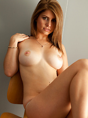 Hailey Leigh sitting on chair and showing her sexual body