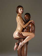 Interracial pair in softcore erotic scene