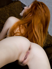 This redhead babe evokes a stunning enchantress with her confident personality, and relaxed but highly suggestive poses.