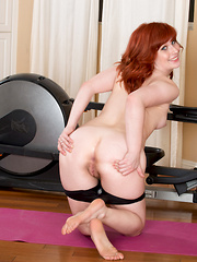 Adorable redhead gets some naughty pleasure after a workout