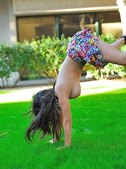Leila does cartwheels topless outside