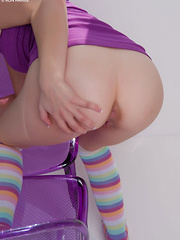Bubbly Delila Darling in her purple tops and rainbow socks spreading her sweet, wet cherries on the chair