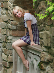 Feeona A dazzles you with the little school girl look. Outfitted in a blue plaid dress with a little white bodice and no panties she shows off her per