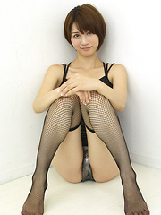 Aki Kogure Asian in fishnets shows some of her boobies in bra