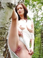 Lara D strips on the grass as she bares her sweet pussy.